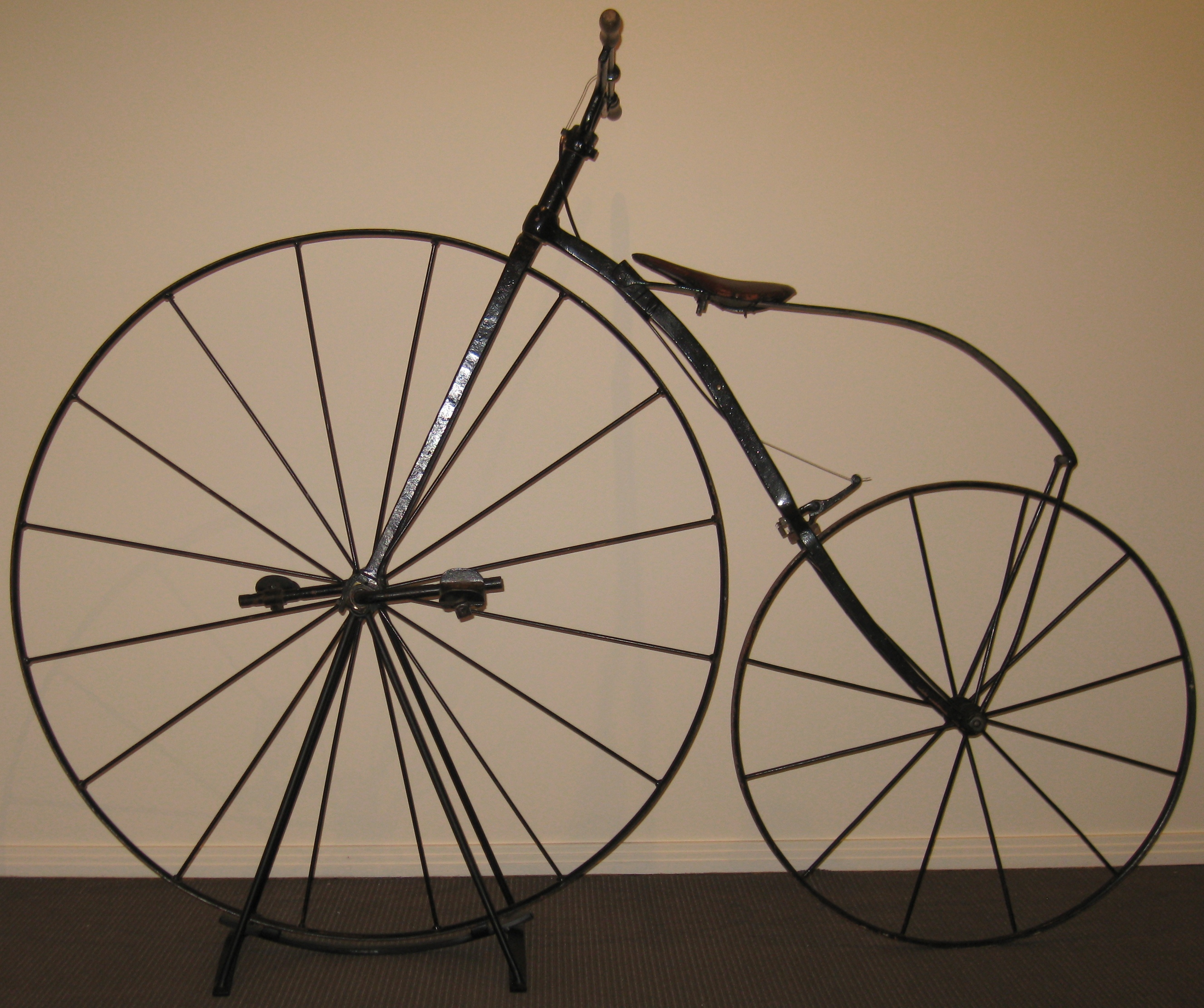 Velocipede, circa 1870s. This velocipede was owned by Athol Kelly who rode it in vintage bicycle races up until the 1990s; hence the modern additions such as brakes. (Gold Museum collection, 99.0014)