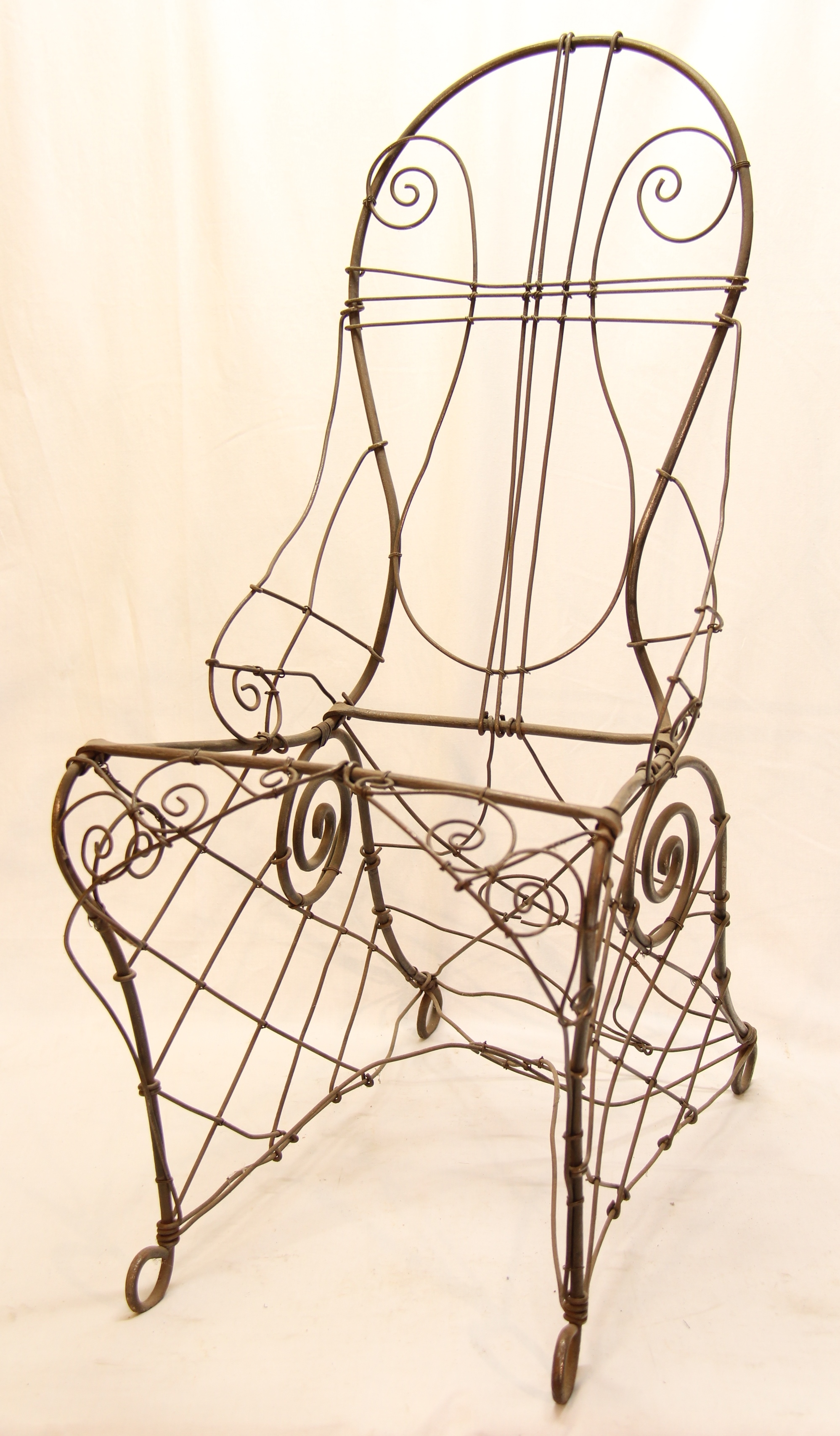 Wire chair from the Geddes Collection (Gold Museum, 77.037)