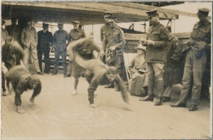 Soldiers taking part in the wheelbarrow race on board the ship Nestor (Gold Museum collection, 2011.0798)