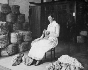 War work: Miss Coll knits a pair of socks from fleece Melbourne, Victoria (Reproduced courtesy of the Australian War Memorial H02438)