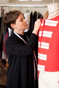Erin Santamaria working on a replica Red Coats uniform, 2016.